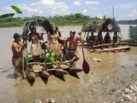 Ecuador Amazon People Travelling in hand made Rafts